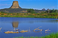 Reflections of Devils Tower and Missouri Buttes in a small reservoir near the monument.  Devils Tower National Monument, Wyoming.