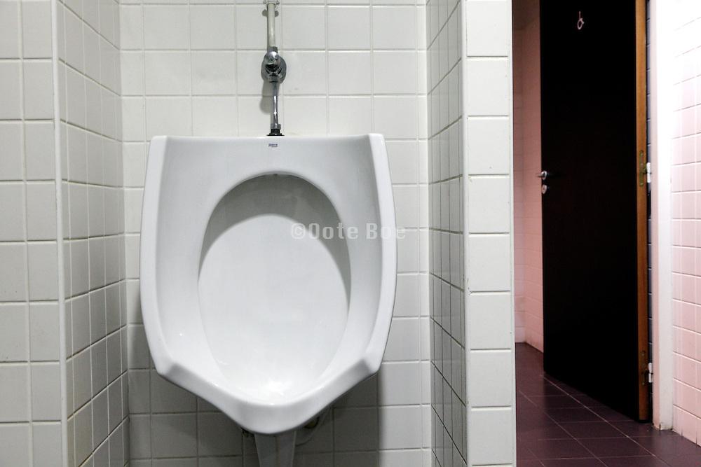 clean white modern design urinal in a public toilet