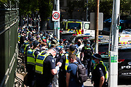 400 protesters were arrested and had to wait in a 300 meter long line to be processed during the Melbourne Freedom Rally at Parliament House. Police move into position on the steps of state parliament ahead of a planed protest. The groups who have organised the many Freedom Day protests over the last 3 months, attempted to march on State Parliament during Melbourne Cup Day demanding the sacking of Premier Daniel Andrews for the lockdown and attacks on their civil liberties. Police met with the protester's with significant force despite the city having had zero cases for five days. (Photo by Dave Hewison/Speed Media)