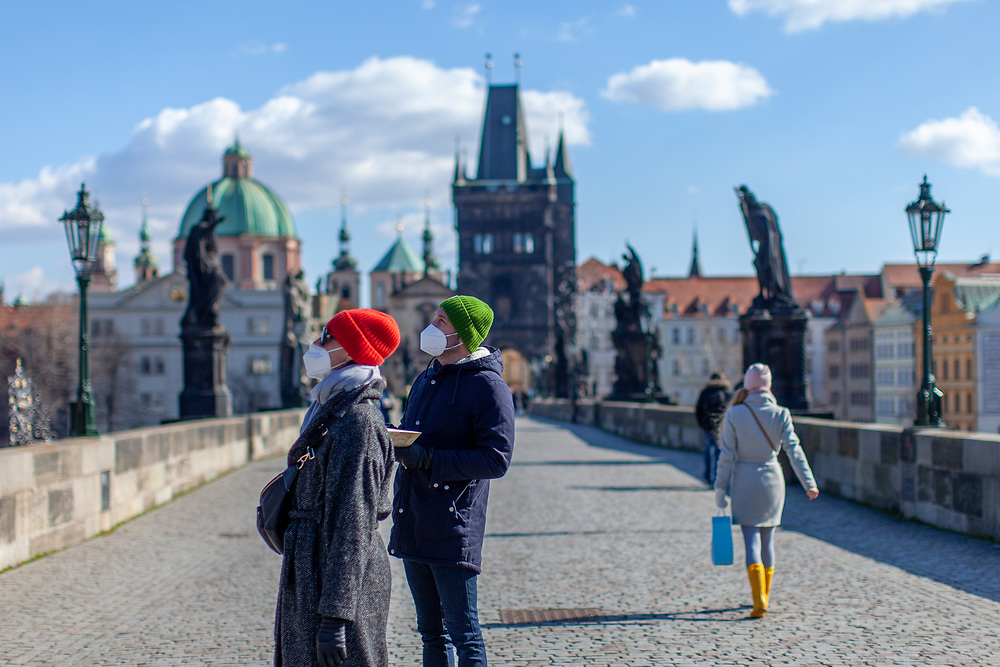 A couple with face masks on Charles Bridge. On March 1st, 2021 the state of emergency in the Czech Republic was reinstalled because of fast increasing numbers in infections. The lockdown was reinstated and the restriction of the free movement of people has taken effect. Currently, the country remains at the highest stage of the anti-epidemiological system and the newly imposed restriction will last at least three weeks to curb the epidemic.
