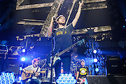 MICHAEL CLIFFORD, LUKE HEMMINGS and CALLUM HOOD of 5 Seconds of Summer perform at the Hot 99.5 Jingle Ball at the Verizon Center in Washington, D.C.