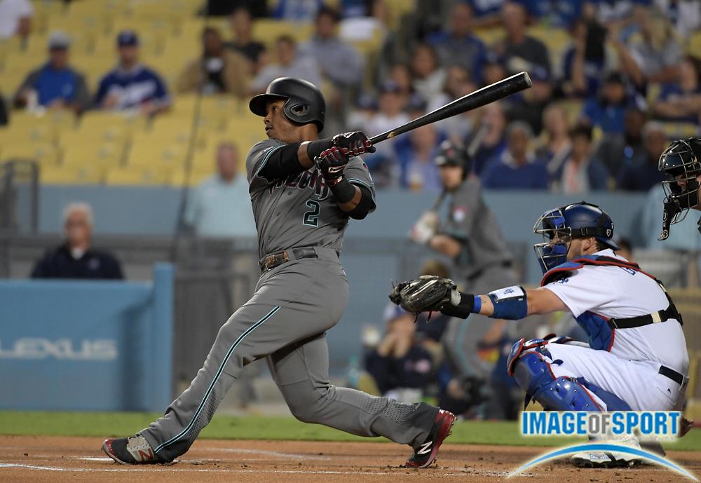 Sep 6, 2016; Los Angeles, CA, USA; Arizona Diamondbacks second baseman Jean Segura (2) bats as Los Angeles Dodgers catcher Yasmani Grandal (9) watches during a MLB game at Dodger Stadium.