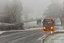 © Licensed to London News Pictures. 06/02/2021. Llanfihangel Nant Melan, Powys, Wales, UK.  Vehicles are driven through a wintry landscape on the A44 road near Llanfihangel Nant melan in Powys, Wales, UK. Photo credit: Graham M. Lawrence/LNP