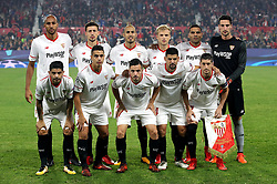 Sevilla players pose for a photograph before kick-off