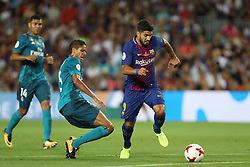 August 13, 2017 - Barcelona, Spain - Luis Suarez of FC Barcelona evades Raphael Varane of Real Madrid during the Spanish Super Cup football match between FC Barcelona and Real Madrid on August 13, 2017 at Camp Nou stadium in Barcelona, Spain. (Credit Image: © Manuel Blondeau via ZUMA Wire)