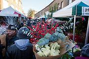 The flower market in December. Columbia Road flower market is held every Sunday and it attracts shoppers from afar. The huge variety in plants and flowers makes it a popular place to shop and the banter between the traders and the quick deals there is to be made makes it a very entertaining place to go.