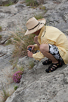 ANGLER TAKING A PICTURE OF FLOWERS DEVILS RIVER TEXAS