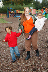 Woman with children in playground