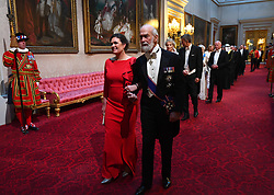Sara Huckabee Sanders and Prince Michael of Kent arrive through the East Gallery during the State Banquet at Buckingham Palace, London, on day one of the US President's three day state visit to the UK.