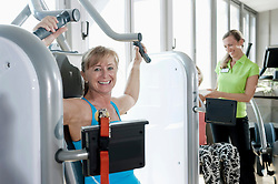 Mature woman fitness trainer studio practicing