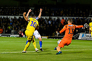 Jack Bonham (13) of Bristol Rovers makes a point blank save from Jake Jervis (10) of AFC Wimbledon during the EFL Sky Bet League 1 match between Bristol Rovers and AFC Wimbledon at the Memorial Stadium, Bristol, England on 23 October 2018.