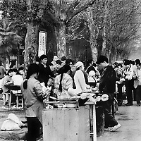 Students gather at the street market food stalls for quick breakfast on their way to class in Wuhan.