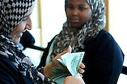 Sco0033837 .  Daily Telegraph..A bank in central Tripoli reopens with heavily armed guards allowing Libyans to withdraw much needed cash before the festival of Eid,  the Muslim holiday that marks the end of Ramadan...Tripoli 29 August 2011. ............Not Getty.Not Reuters.Not AP.Not Reuters.Not PA....