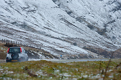 © Licensed to London News Pictures. 14/02/2014. Storey Arms, Brecon Beacons, Powys, Wales, UK. Traffic makes it's way up to Story Arms 425metres above sea level on the A470 road between Brecon and Merthyr Tydfil. Snow, driving hail and storm force winds hit the Brecon Beacons. Photo credit : Graham M. Lawrence/LNP