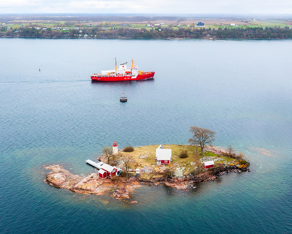 https://Duncan.co/small-island-with-lighthouse-and-coast-guard-ship