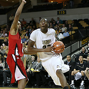 Central Florida forward Keith Clanton (33) drives to the basket during their game against Louisiana at the UCF Arena on December 15, 2010 in Orlando, Florida. UCF won the game79-58. (AP Photo/Alex Menendez)