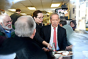 Lebanon Diner owner Karen Liot Hill moves former New York Governor George Pataki's breakfast plate to another table to encourage him to speak with more guests as Dan Nash, of Lebanon, looks on at left, during an event at the restaurant in Lebanon, N.H. Monday, Feb. 2, 2015. Pataki is visiting voters in the region and considering a run for the presidency. (Valley News - James M. Patterson)<br /> Copyright © Valley News. May not be reprinted or used online without permission. Send requests to permission@vnews.com.