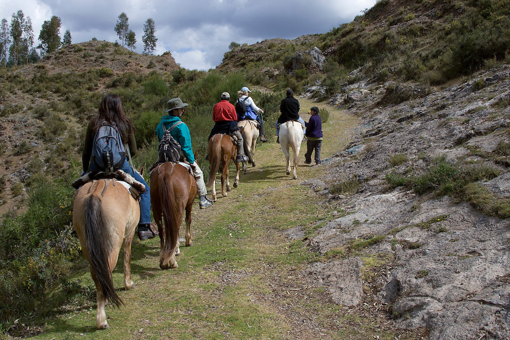 Tourists horseback riding to Temple of the Moon, Cuzco, Peru, South America