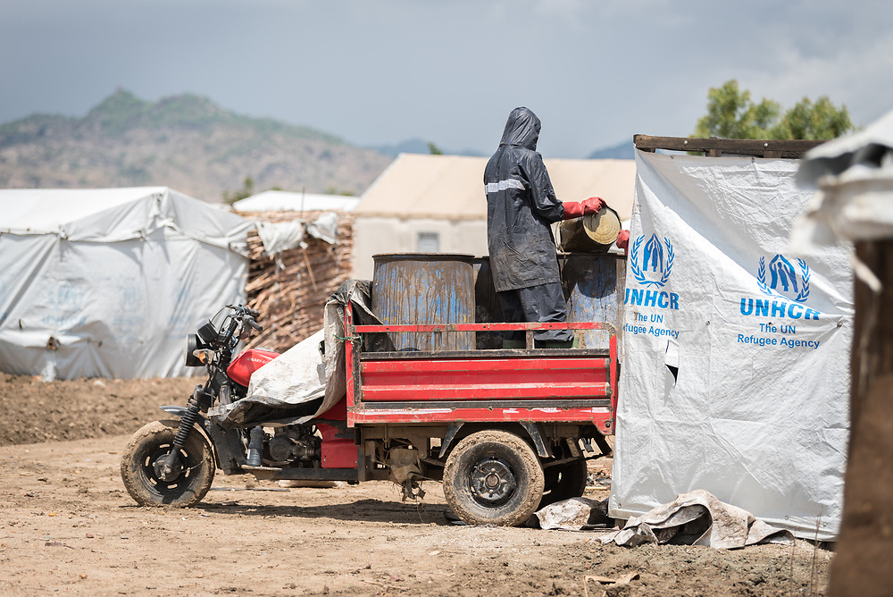 30 May 2019, Mokolo, Cameroon: Refugees work to empty a series of emergency latrines in the Minawao camp for Nigerian refugees. 27 refugees undertake this task regularly, helping to maintain the functionality of the 2,000 or so latrines currently in service around the camp. The Minawao camp for Nigerian refugees, located in the Far North region of Cameroon, hosts some 58,000 refugees from North East Nigeria. The refugees are supported by the Lutheran World Federation, together with a range of partners.