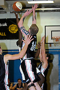 UK, Chelmsford - Thursday, March 05, 2009: Baddow Eagle defenders put pressure on Martin Overare as he drives to the basket during the Essex Basketball League game Erkenwald at Baddow Eagles. Erkenwald won the game 94 - 75. (Image by Peter Horrell / http://www.peterhorrell.com)