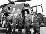 Mr James Tully TD, Minister for Defence, inspecting the latest addition to the Air Corps fleet – a French-built SA 330J 'Puma' twin-engined helicopter – at Casement Aerodrome, Baldonnell, County Dublin. Centre: Brig-General William Glenn, GOC Air Corps. Also Comdt. Hugh O'Donnell (left) and Comdt. Ken Byrne.<br /> 22 July 1981