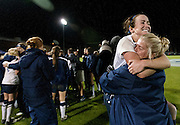 BYU's Michele Murphy jumps into the arms of a BYU coach during the NCAA Women's Soccer Sweet 16 match between BYU and Marquette University at BYU , Saturday, Nov. 17, 2012.