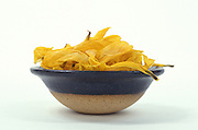 Ceramic bowl full of dried yellow petals