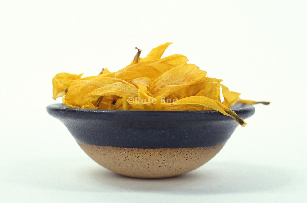 Ceramic bowl full of dried yellow petals