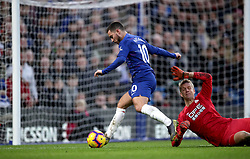 Chelsea's Eden Hazard (centre) scores his side's third goal of the game during the Premier League match at Stamford Bridge, London.