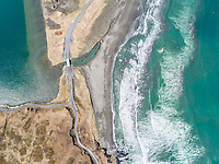 Aerial view of turquoise bay and coastal road in Dutch Harbor, Alaska, USA.