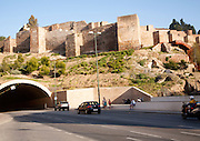Traffic entering vehicle tunnel under historic Alcazaba fortress, Malaga, Spain