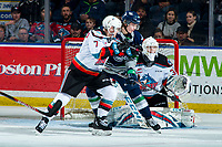 KELOWNA, BC - JANUARY 24: \Conner Roulette #34 of the Seattle Thunderbirds is checked by Conner McDonald #7 as Cole Schwebius #31 of the Kelowna Rockets makes a first period save at Prospera Place on January 24, 2020 in Kelowna, Canada. (Photo by Marissa Baecker/Shoot the Breeze)