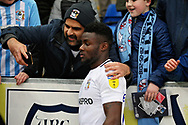 Coventry City forward Bright Enobakhare (24) celebrates with a fan selfie after the EFL Sky Bet League 1 match between Peterborough United and Coventry City at London Road, Peterborough, England on 16 March 2019.