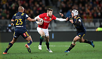 Rugby Union - 2017 British & Irish Lions Tour of New Zealand - Highlanders vs. British & Irish Lions<br /> <br /> Elliot Daly of The British and Irish Lions passes Patrick Osborne and Teihorangi Walden of Highlanders at Forsyth Barr Stadium, Dunedin.<br /> <br /> COLORSPORT/LYNNE CAMERON