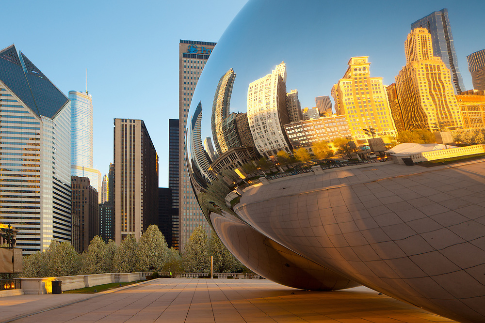 Chicago, Illinois, United States - Michigan Avenue skyline reflected on Cloud Gate.