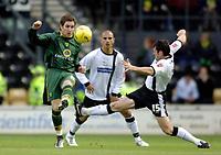 Photo: Glyn Thomas.<br />Derby County v Norwich City. Coca Cola Championship.<br />03/12/2005.<br />Derby's Adam Bolder (R) challenges Jim Brennan.