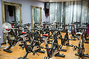 A room set up with lots of exercise bikes for a fitness spinning class in London, England, United Kingdom.
