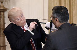 June 22, 2017 - Washington, District of Columbia, U.S. - President DONALD TRUMP curiously inspects a drone as George Mathew CEO & Chairman of Kespry explains how it works during  the American Leadership in Emerging Technology Event in the East Room of the White House.(Credit Image: © Olivier Douliery/CNP via ZUMA Wire)