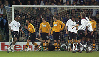 Photo. Glyn Thomas.<br /> Fulham v Blackburn. FA Barclaycard Premiership. <br /> Loftus Road, Luton. 12/04/2004.<br /> Fulham Luis Boa Morte (L) is delighted to have scored his side's equaliser while Blackburn's Lorenzo Amoruso (second from R) pleads with the referee not to award it.