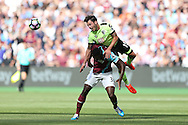 Adam Smith of Bournemouth heads the ball over Michail Antonio of West Ham United. Premier league match, West Ham Utd v AFC Bournemouth at the London Stadium, Queen Elizabeth Olympic Park in London on Sunday 21st August 2016.<br /> pic by John Patrick Fletcher, Andrew Orchard sports photography.
