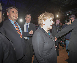 The half-Scottish governor of Lower Saxony, David McAllister and German Chancellor Angela Merkel arriving at an election campaign event at Hildesheim, Germany..©Michael Schofield.