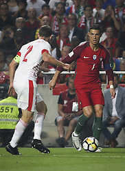 October 10, 2017 - Lisbon, Portugal - Portugal's forward Cristiano Ronaldo (R) vies with .Switzerland's defender Stephan Lichtsteiner during the FIFA 18 World Cup Qualifier match between Portugal and Switzerland at the Luz Stadium on October 10, 2017 in Lisbon, Portugal. (Credit Image: © Carlos Costa/NurPhoto via ZUMA Press)