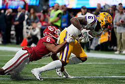 Terrace Marshall Jr. #6 of the LSU Tigers catches a pass for a touchdown against Tre Brown #6 of the Oklahoma Sooners during the first half of the 2019 College Football Playoff Semifinal at the Chick-fil-A Peach Bowl on Saturday, Dec. 28, in Atlanta. (Paul Abell via Abell Images for the Chick-fil-A Peach Bowl)
