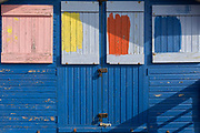 The detail of the colour samples being tried on the exterior of a wooden beach hut, on 31st March 2019, in Whitstable, Kent, England.