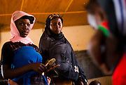 A woman grimaces as she sees a child getting injected with meningitis vaccine at a MSF vaccination site in Tibiri, Niger on Friday April 17, 2009.