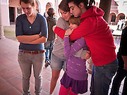 tucsonshooting - 09 JANUARY 2011 - TUCSON, AZ: Nadine Heiden (CQ), 16, Stella Chavin, 17 (CQ), Marilyn Hill (CQ) 12, and Ally Tanzillo (CQ) 19, comfort each other at a memorial in downtown Tucson Sunday for Congresswoman Gabrielle Giffords and other victims of the mass shooting that took place Saturday.   ARIZONA REPUBLIC PHOTO BY JACK KURTZ