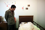 Miao Yuqiang visits his mother, Qiu Jinzhen, who suffers from dementia, at the Shanghai 3rd Welfare House in Shanghai, China on 28 November 2010.   Dementia and Alzheimer's is fast establishing themselves as a major health risk for China's booming elderly population, placing strain on families and society a like, especially in major cities such as Shanghai, where the traditional system of large family and caring for the old by family members give way to small family units and retirement homes.