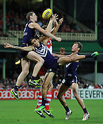 Michael Walters, Garrick Ibbotson of the Dockers and Mike Pyke of the Swans contest a mark during the 2013 AFL round 08 match between the Sydney Swans and the Fremantle Dockers at the SCG, Sydney on May 18, 2013. (Photo: Craig Golding/AFL Media)