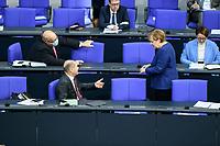 08 DEC 2020, BERLIN/GERMANY:<br /> Peter Altmaier (L), MdB, CDU, Bundeswirtschaftsminister, Olaf Scholz (M), MdB, SPD, Bundesfinanzminister, Angela Merkel (R), CDU, Bundeskanzlerin im Gespraech, Haushaltsdebatte, Plenum, Reichstagsgebaeude, Deuscher Bundestag<br /> IMAGE: 20201208-02-076<br /> KEYWORDS: Gespräch