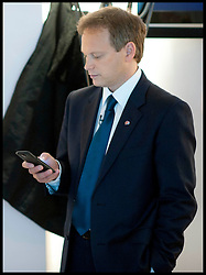 Co-Chairman of the Conservative Party Grant Shapps checks his mobile phone before his speech at the Conservative Party Conference in Birmingham, Sunday October 7, 2012.<br /> <br /> The Conservatives were under fire last night over a 'condescending' pitch for the working class vote - after launching an Internet advert which highlighted Budget cuts to beer and bingo duty.<br /> Conservative Party chairman Grant Shapps took to Twitter last night to launch an advert devised by Tory HQ to highlight Budget measures supposedly aimed at 'hardworking people. Picture by Andrew Parsons / i-Images